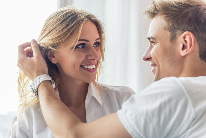 Head shot woman anxious worried woman sitting on couch at home. Frustrated confused female feels unhappy, problems in personal life, quarrel break up with boyfriend and unexpected pregnancy concept