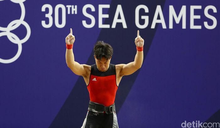 Atlet angkat besi, Rahmat Erwin Abdullah, berhasil menambah koleksi medali emas Kontingen Indonesia di SEA Games 2019 Filipina. Dia menjadi yang terbaik di kelas 73 kg putra.