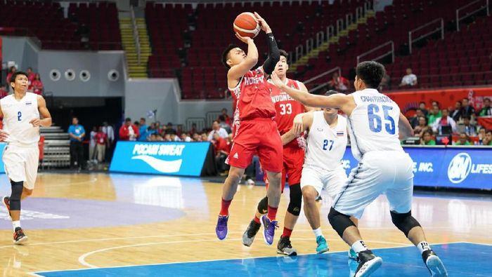 Andakara Prastawa di Timnas Basket Indonesia vs Thailand pada SEA GAmes 2019 di Mall Of Asia Arena, Manila, Rabu (4/12/2019).  (dok. Humas PP Perbasi)