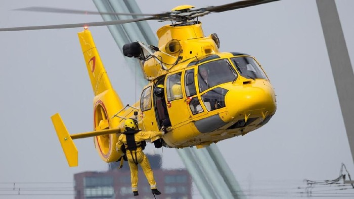 ROTTERDAM, NETHERLANDS - SEP 3, 2016: Eurocopter AS365 Daupin rescue helicopter from NHV-Noordzee Helikopters in action.