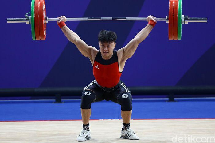 Atlet angkat besi, Rahmat Erwin Abdullah, menambah koleksi medali emas Indonesia di SEA Games 2019 Filipina. Dia menjadi yang terbaik di kelas 73 kg putra.