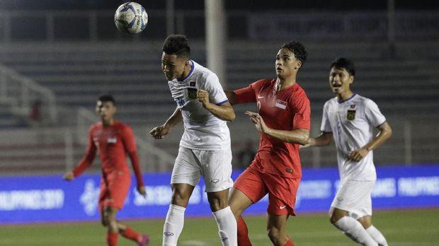 Laos (putih) diprediksi akan bermain bertahan.