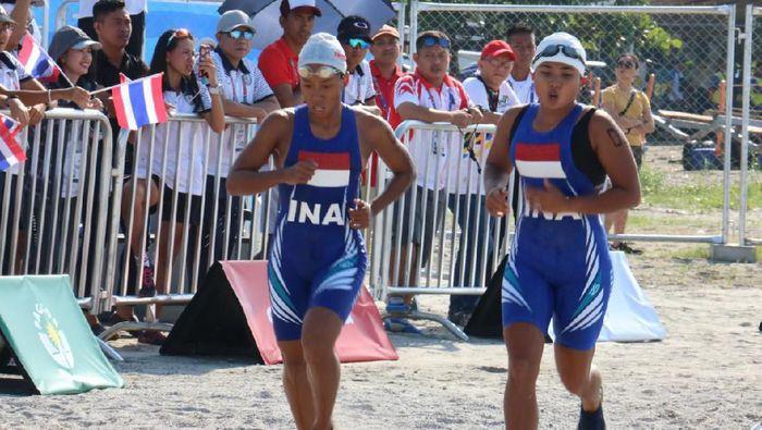 Cintya Nariska (kanan) di SEA Games 2019 modern pentathlon beach triathle perorangan putri, Jumat (6/12/2019). (dok. NOC)