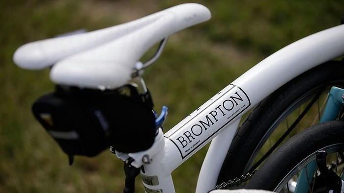 CHICHESTER, ENGLAND - JULY 28:  A bike wears the name Brompton at the Brompton World Championship folding bike race, which is part of the Orbital cycling festival at Goodwood Motor Circuit on July 28, 2013 in Chichester, England. The race starts with a Le-Mans style sprint to the riders bike, which is then assembled and followed by a 15.2km ride. A strict dress code of jacket and tie applies, with an award going to the most stylishly dressed.  (Photo by Matthew Lloyd/Getty Images)