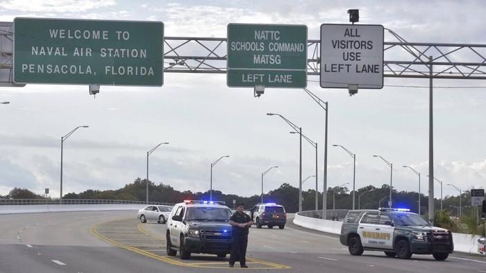 Penembakan di Pangkalan Stasiun Udara AL Florida (Foto: Tony Giberson/ Pensacola News Journal via AP)