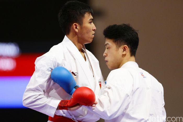 egini aksi Rifki (merah) saat membawa nama Indonesia di ajang SEA Games 2019 di Filipina.