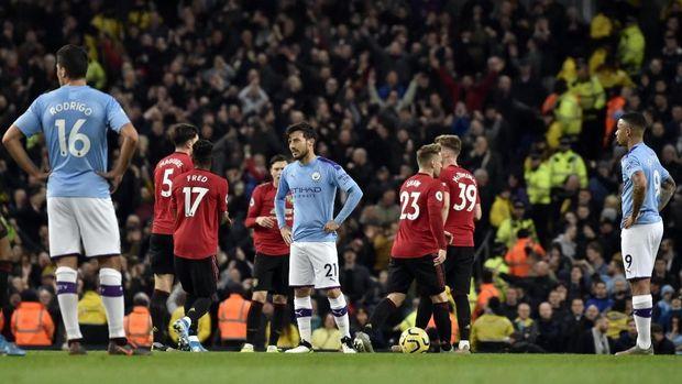 Manchester City kalah 1-2 dari MU di pertemuan pertama Liga Inggris musim ini. (