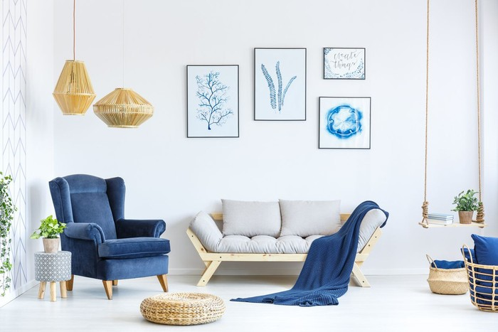 Armchair with flowery pillow in blue and white living room