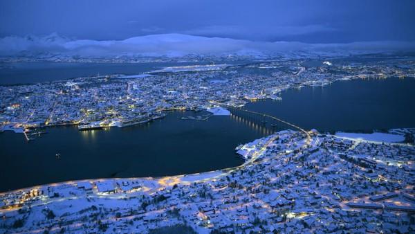 Kemasilah pakaian hangat terberat Anda dan pergilah ke Tromso, Norwegia. Semua indera Anda akan lebih peka ketika berlibur di sana (Foto: CNN)