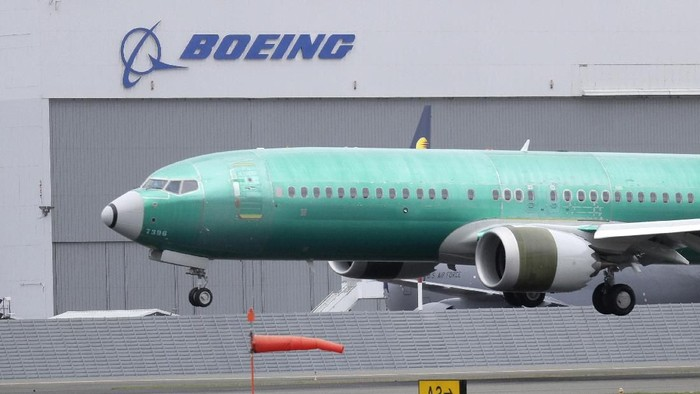 FILE - In this April 10, 2019, file photo a Boeing 737 MAX 8 airplane being built for India-based Jet Airways lands following a test flight at Boeing Field in Seattle. Boeing is reassuring airline industry leaders about the safety of the grounded 737 Max as it continues working to get the plane back in service. The aircraft maker invited about 30 union officials, safety experts and others to the Seattle area for two days of meetings with Boeing executives and factory tours. (AP Photo/Ted S. Warren, File)