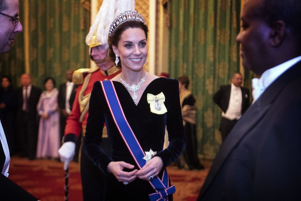 L0NDON, ENGLAND - DECEMBER 11: Catherine, Duchess of Cambridge talks to guests at an evening reception for members of the Diplomatic Corps at Buckingham Palace on December 11, 2019 in London, England.(Photo by Victoria Jones - WPA Pool/Getty Images)