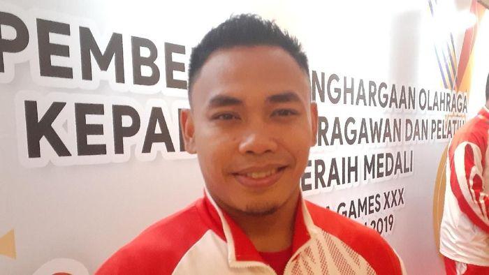 Lifter Eko Yuli Irawan kaget karena besaran bonus SEA Games dinaikkan. (Foto: Adhi Prasetya)