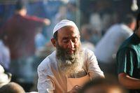 Muslim Uighur di Xianjiang.