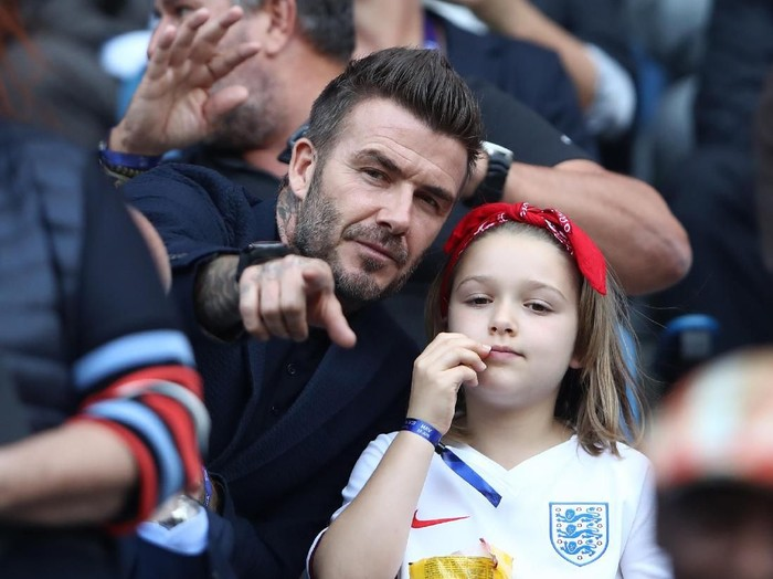 LE HAVRE, FRANCE - JUNE 27:  David Beckham is seen in the stands with his daughter, Harper, prior to the 2019 FIFA Womens World Cup France Quarter Final match between Norway and England at Stade Oceane on June 27, 2019 in Le Havre, France. (Photo by Alex Grimm/Getty Images)