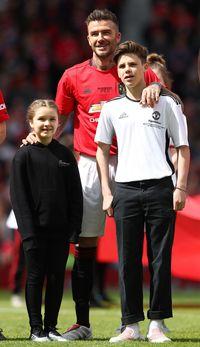 David Beckham bersama kedua anaknya, Cruz dan Harper.
