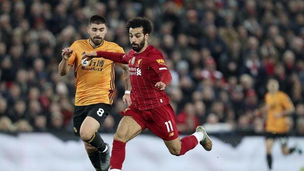 Liverpool unggul 13 poin di Liga Inggris usai mengalahkan Wolverhampton.