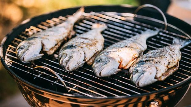 Fish Fried On The Grill Outdoor. Spanish Cuisine