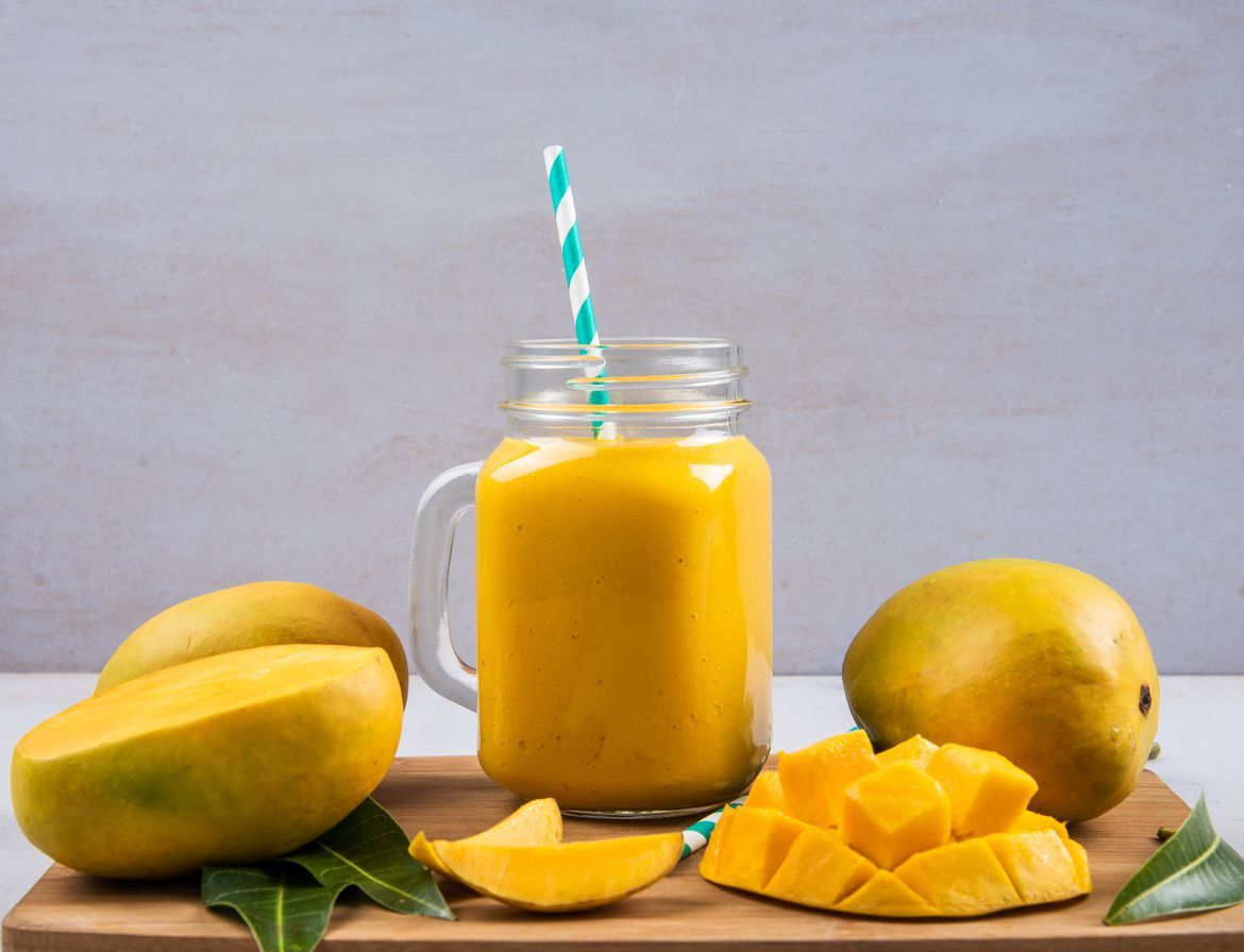Mango Smoothie In A Bottle With Slices Of Mango Fruit