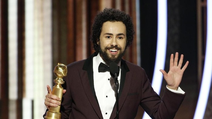 BEVERLY HILLS, CALIFORNIA - JANUARY 04: In this handout photo provided by NBCUniversal Media, LLC,  Ramy Youssef accepts the award for BEST PERFORMANCE BY AN ACTOR IN A TELEVISION SERIES - MUSICAL OR COMEDY for Ramy onstage during the 76th Annual Golden Globe Awards at The Beverly Hilton Hotel on January 5, 2020 in Beverly Hills, California. (Photo by Paul Drinkwater/NBCUniversal Media, LLC via Getty Images)