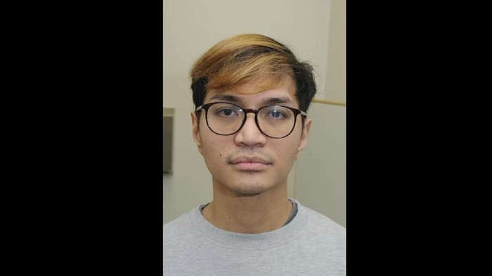 """This is an undated handout photo issued by  Greater Manchester Police (GMP) on Monday, Jan. 6, 2020 of Reynhard Sinaga.  A man described as """"the most prolific rapist in British legal history"""" has been sentenced to life in prison with a possible release after 30 years following his conviction for sexual offenses against 48 men. (GMP via AP)"""