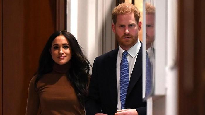 Pangeran Harry dan Meghan Markle mundur sebagai anggota senior Kerajaan Inggris. Foto: DANIEL LEAL-OLIVAS  - WPA Pool/Getty Images