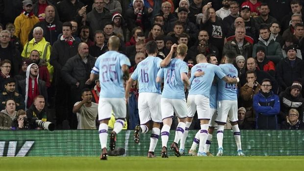 Man City berpestas di Old Trafford.