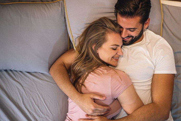 Young couple  lying in the bed early in the morning in bedroom