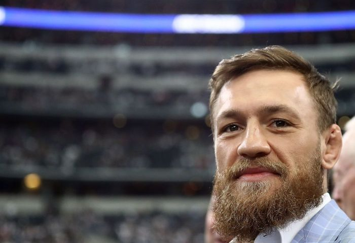 ARLINGTON, TX - OCTOBER 14:  Conor McGregor is seen on the sidelines before the NFL game between the Jacksonville Jaguars and Dallas Cowboys at AT&T Stadium on October 14, 2018 in Arlington, Texas.  (Photo by Ronald Martinez/Getty Images)
