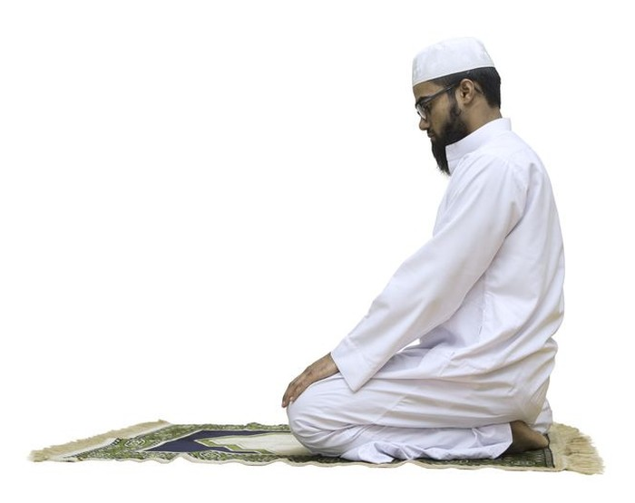 A young muslim in prayer