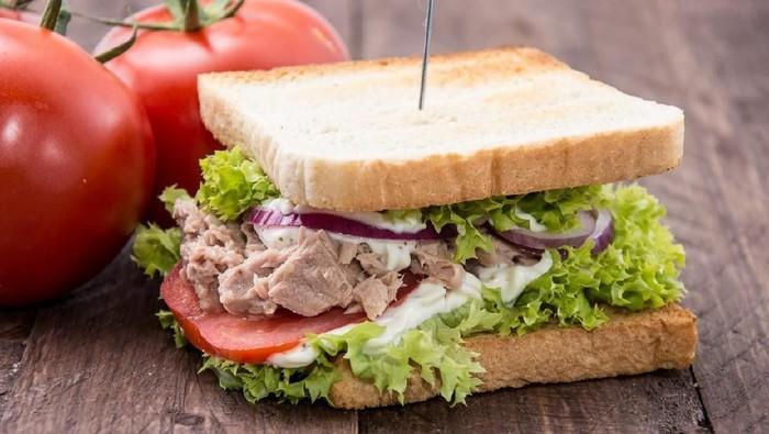 Fresh made Tuna Sandwiches on wooden background