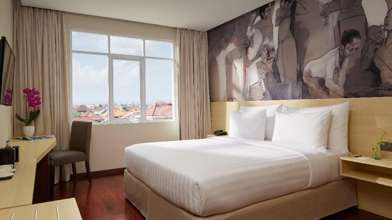 Kamar deluxe king  (dok Four Star by Trans Hotel )
