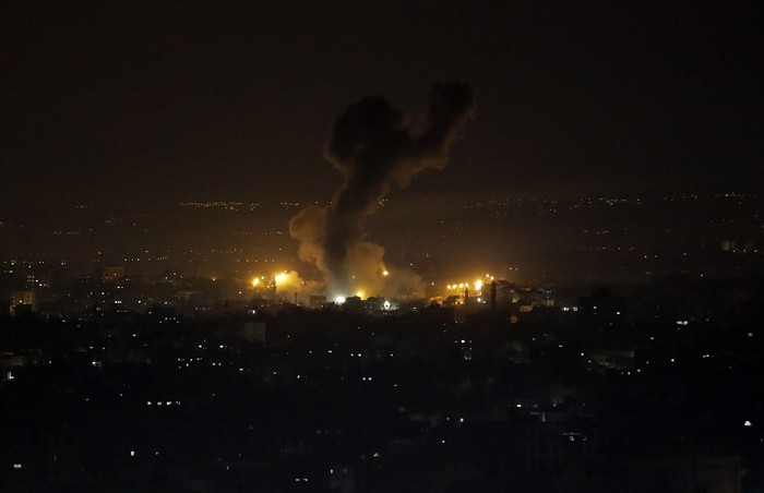An explosion caused by Israeli airstrikes is seen on Gaza City, Wednesday, Jan. 15, 2020. Israel reportedly targeted several Hamas military sites in the northern Gaza strip after claims that Palestinian militants had fired four rockets at southern Israel. (AP Photo/Adel Hana)
