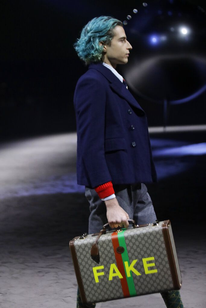 A model wears a creation as part of the Gucci men's Fall-Winter 2020/21 collection, that was presented in Milan, Italy, Tuesday, Jan. 14, 2020. (AP Photo/Luca Bruno)