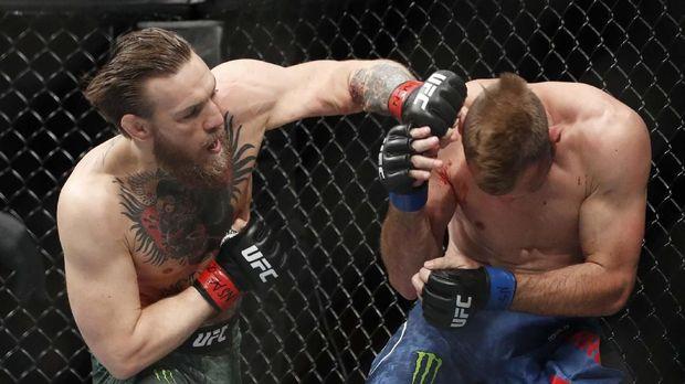 Conor McGregor saat mengalahkan Cowboy Cerrone dalam waktu 40 detik. (