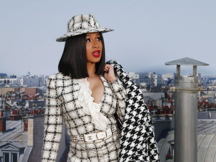File - In this Tuesday, Oct. 1, 2019 file photo, Singer Cardi B poses for photographers as she arrives for the Chanel Ready To Wear Spring-Summer 2020 collection in Paris, France. Cardi Bs announcement in a tweet on Friday, Jan. 3, 2020 that she wants to seek Nigerian citizenship has set off a Twitter feud between her West African fans in friendly rivals Nigeria and Ghana. (AP Photo/Francois Mori, file)