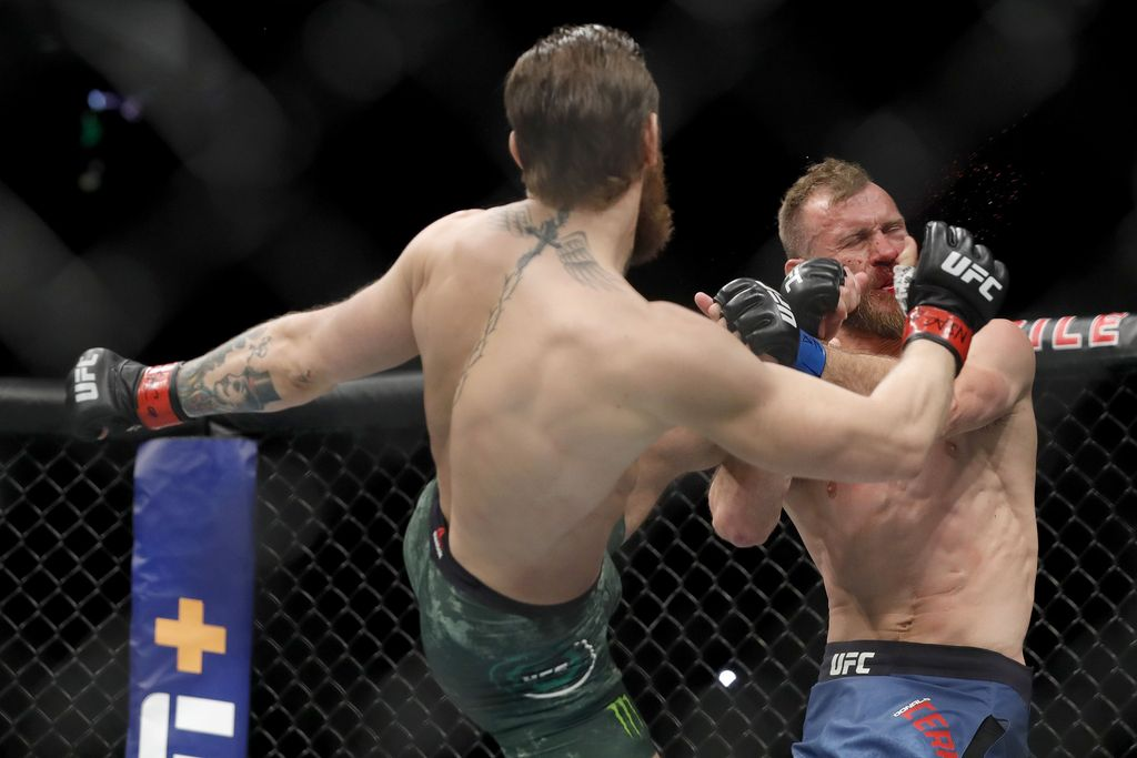 LAS VEGAS, NEVADA - JANUARY 18:  Conor McGregor lands a kick to the face of Donald Cerrone in the first round in a welterweight bout during UFC246 at T-Mobile Arena on January 18, 2020 in Las Vegas, Nevada.  (Photo by Steve Marcus/Getty Images)
