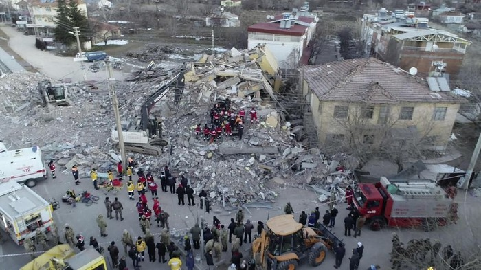 Rescue workers on a collapsed building after a strong earthquake struck Sivrice town in Elazig province, eastern Turkey, Friday, Jan. 24, 2020. The earthquake rocked a sparsely-populated part of eastern Turkey on Friday, injuring more than 500 and leaving some 30 trapped in the wreckage of toppled buildings, Turkish officials said.(DHA via AP)