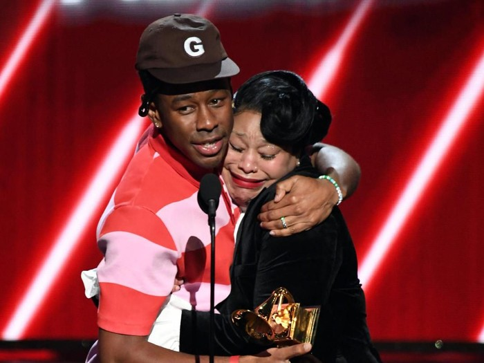 LOS ANGELES, CALIFORNIA - JANUARY 26: (L-R) Tyler, the Creator and his mother accept the Best Rap Album award for Igor onstage during the 62nd Annual GRAMMY Awards at STAPLES Center on January 26, 2020 in Los Angeles, California. (Photo by Kevin Winter/Getty Images for The Recording Academy )