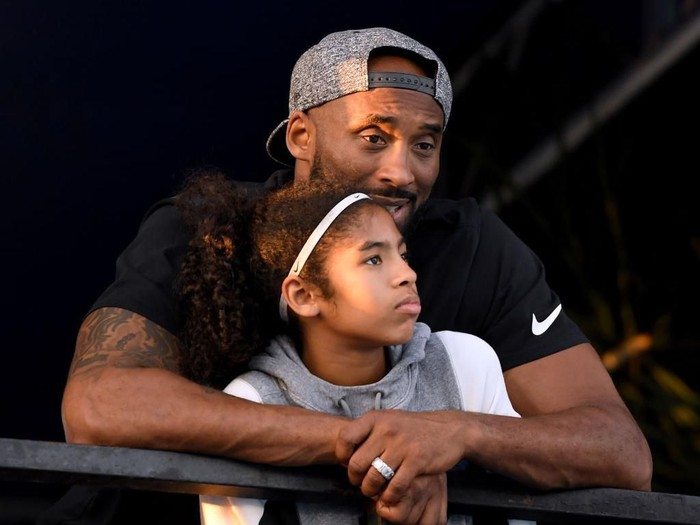 IRVINE, CA - JULY 26:  Kobe Bryant and daughter Gianna Bryant watch during day 2 of the Phillips 66 National Swimming Championships at the Woollett Aquatics Center on July 26, 2018 in Irvine, California.  (Photo by Harry How/Getty Images)