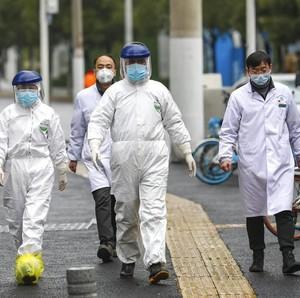 Lawan Virus Corona, Perawat di China Cukur Rambut Panjang hingga Botak