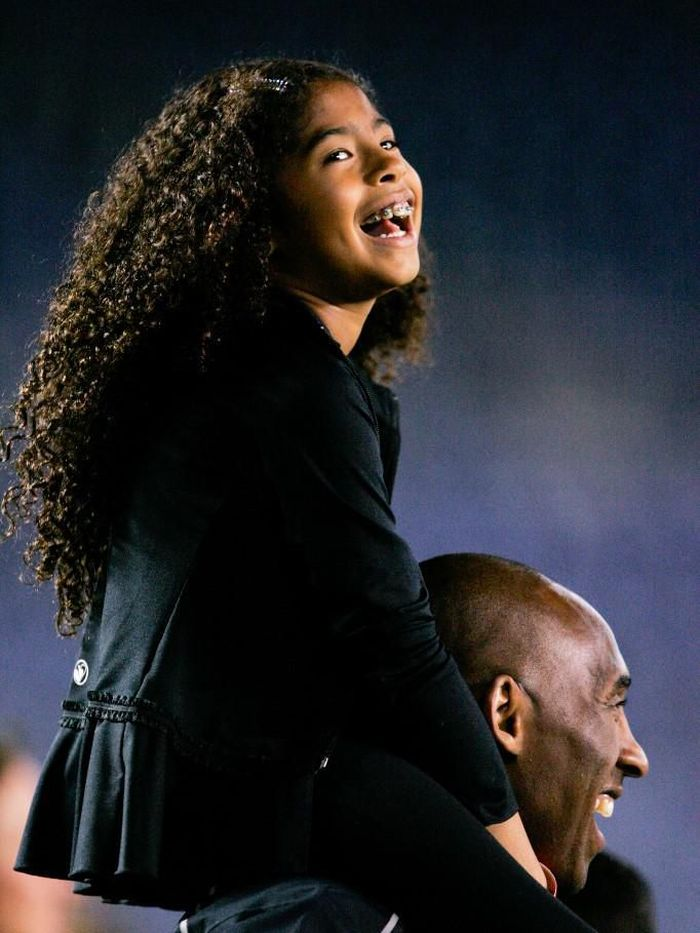 SAN DIEGO, CA - APRIL 10: NBA Los Angeles Laker Kobe Bryant stands on the sideline with his daughter Gianna Maria-Onore Bryant on his shoulders prior to the start of the game against the United States and China during an international firendly match at Qualcomm Stadium on April 10, 2014 in San Diego, California.   Kent C. Horner/Getty Images/AFP