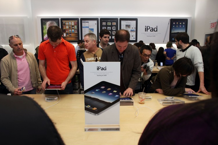 NEW YORK - APRIL 03:  People at the SoHo New York Apple store try out Apple Incs new iPad on April 3, 2010 in New York City. Hundreds lined up in front of the technology companys flagship New York store on the Avenue to be among the first in the world to acquire the device. The much heralded iPad looks to be a bridge between a laptop and smartphone.  (Photo by Spencer Platt/Getty Images)