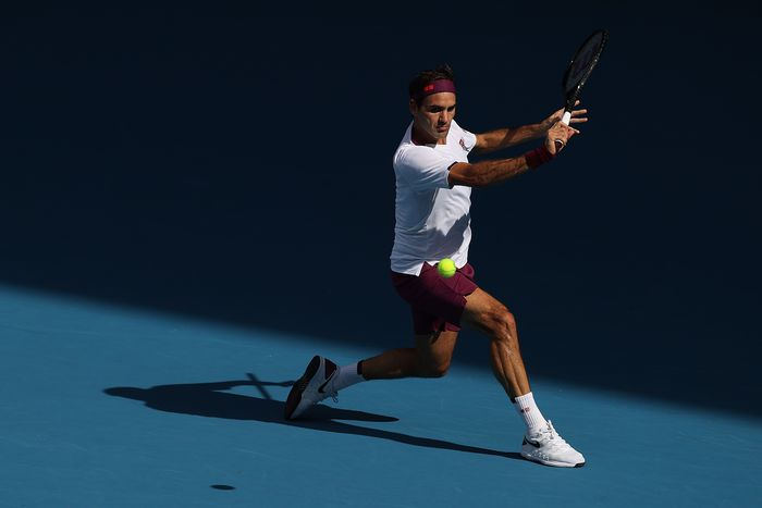 MELBOURNE, AUSTRALIA - JANUARY 28: Roger Federer of Switzerland plays a backhand during his Men's Singles Quarterfinal match against Tennys Sandgren of the United States on day nine of the 2020 Australian Open at Melbourne Park on January 28, 2020 in Melbourne, Australia. (Photo by Clive Brunskill/Getty Images)