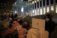 NEW YORK - APRIL 2:  Sinai Azmoudea, 23, of Dallas Texas, right, waits on line for the release of Apples iPad on April 2, 2010 at the Apple Store on Fifth Avenue in New York City. Employees set up barriers to control the throngs expected to line up for the $499 device which goes on sale Saturday. (Photo by David Goldman/Getty Images)