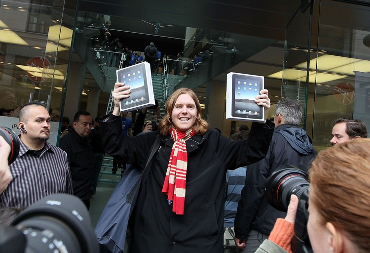 SAN FRANCISCO - APRIL 03:  Apple customer Andres Schobel holds up his two new iPads at an Apple store April 3, 2010 in San Francisco, California. Hundreds of people lined up hours before the Apple store opened to purchase the new iPad which debuted today.  (Photo by Justin Sullivan/Getty Images)