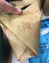 Ini Arti Kode yang Tertulis pada Bungkus Nasi Padang