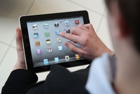 LONDON, ENGLAND - FEBRUARY 17:  In this photo illustration, a man holds an Apple ipad tablet on February 17, 2011 in London, England. Apple sold two million ipads in the first two months of their launch in 2010. Worldwide iPad sales are expected to amount to 20 million in 2012.  (Photo Illustration by Peter Macdiarmid/Getty Images)