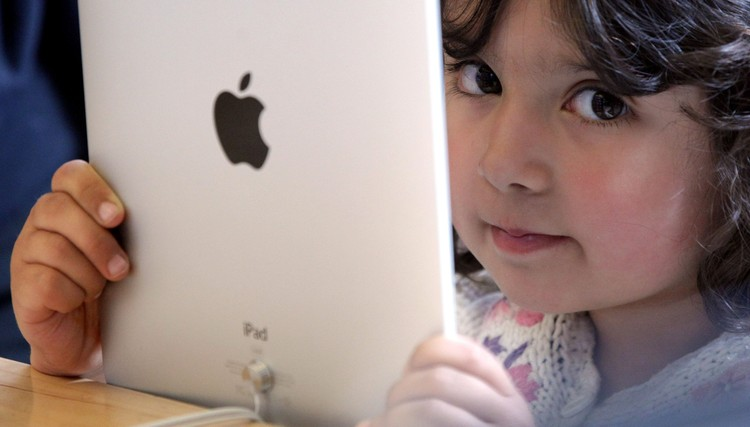 LONDON, ENGLAND - MAY 28:  A young girl holds an Apple iPad on display at Regent Streets Apple store on May 28, 2010 in London, England. Apple iPads went on sale today in countries including Japan, Australia, Germany, Italy, Canada, Switzerland and the United Kingdom as part of Apples global roll-out of the hugely successful new device.  (Photo by Dan Kitwood/Getty Images)