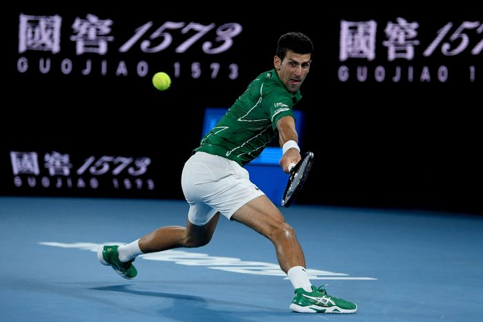MELBOURNE, AUSTRALIA - JANUARY 28: Novak Djokovic of Serbia plays a backhand during his Men's Singles Quarterfinal match against Milos Raonic of Canada on day nine of the 2020 Australian Open at Melbourne Park on January 28, 2020 in Melbourne, Australia. (Photo by Hannah Peters/Getty Images)