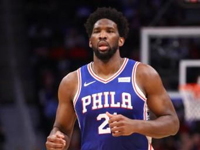 DETROIT, MICHIGAN - DECEMBER 23: Joel Embiid #21 of the Philadelphia 76ers plays against the Detroit Pistons at Little Caesars Arena on December 23, 2019 in Detroit, Michigan. NOTE TO USER: User expressly acknowledges and agrees that, by downloading and or using this photograph, User is consenting to the terms and conditions of the Getty Images License Agreement.   Gregory Shamus/Getty Images/AFP